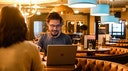 Person enjoying working from a cosy bar